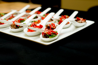 Team member holding a tray of canapés