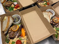 Salad boxes lined up for corporate meeting
